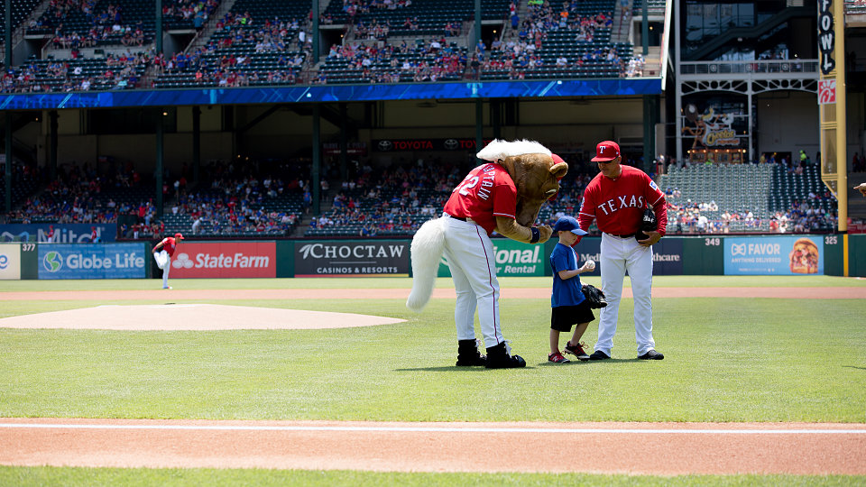 5 year old adopted through buckner international throws out ceremonial first pitch at texas rangers