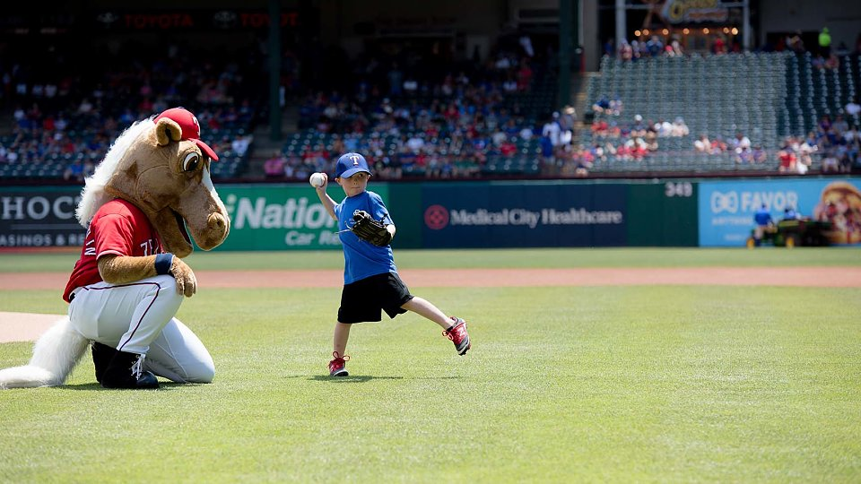 adopted child through buckner international throws first pitch at texas rangers game