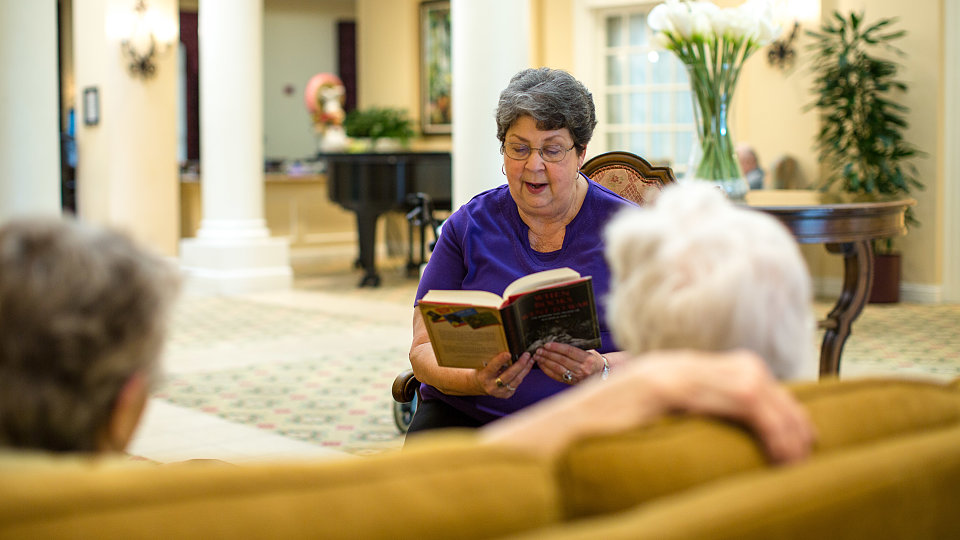 Barbara McNeir reading to the residents