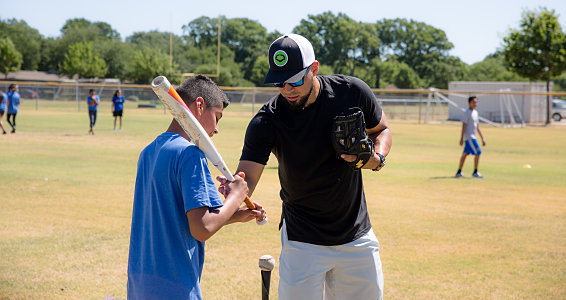 Friday photo: Robinson Chirinos plays baseball with children Buckner serves
