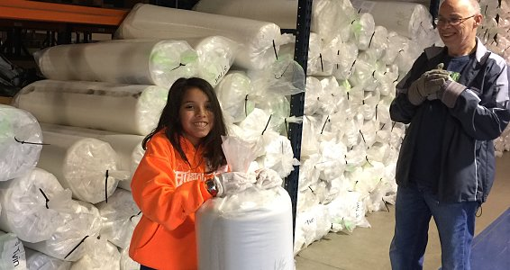 Friday photo: Bed Boss donates 1,000 mattresses to Buckner