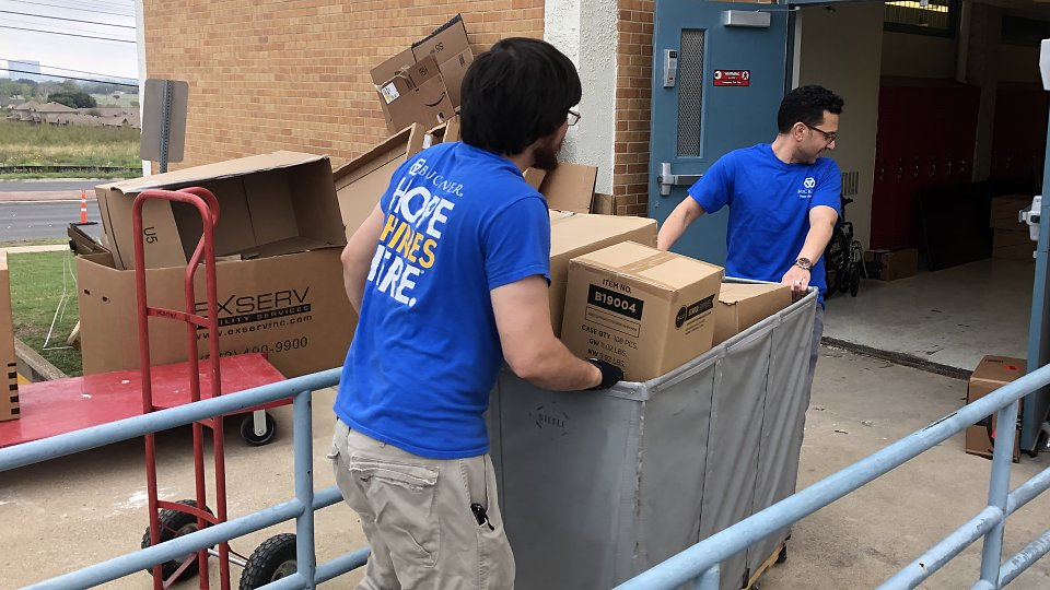 buckner international delivers supplies for disd students in need