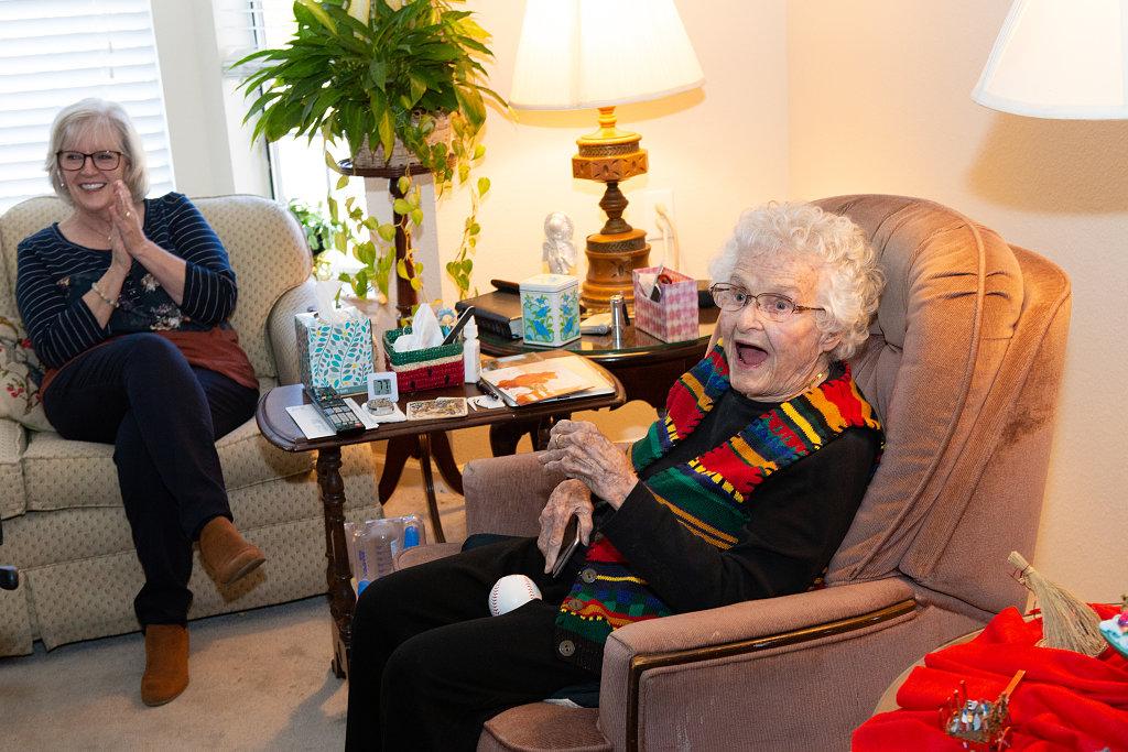 Elderly woman in chair smiling