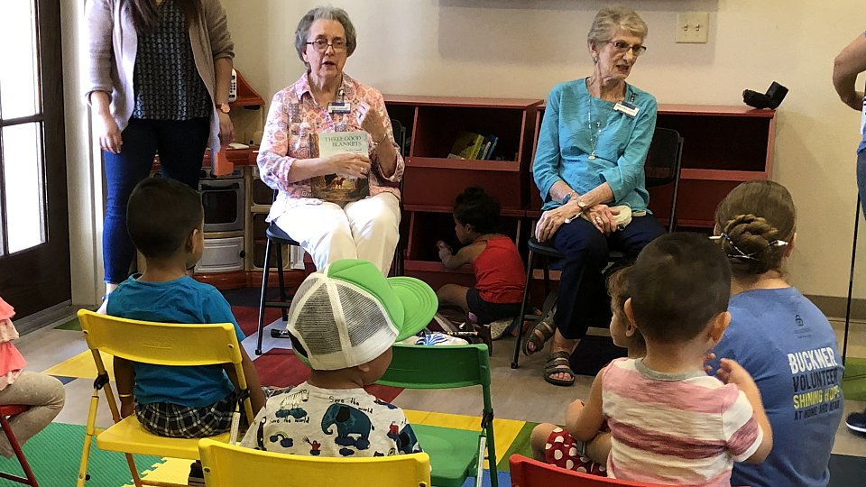 buckner westminster place member reads to children