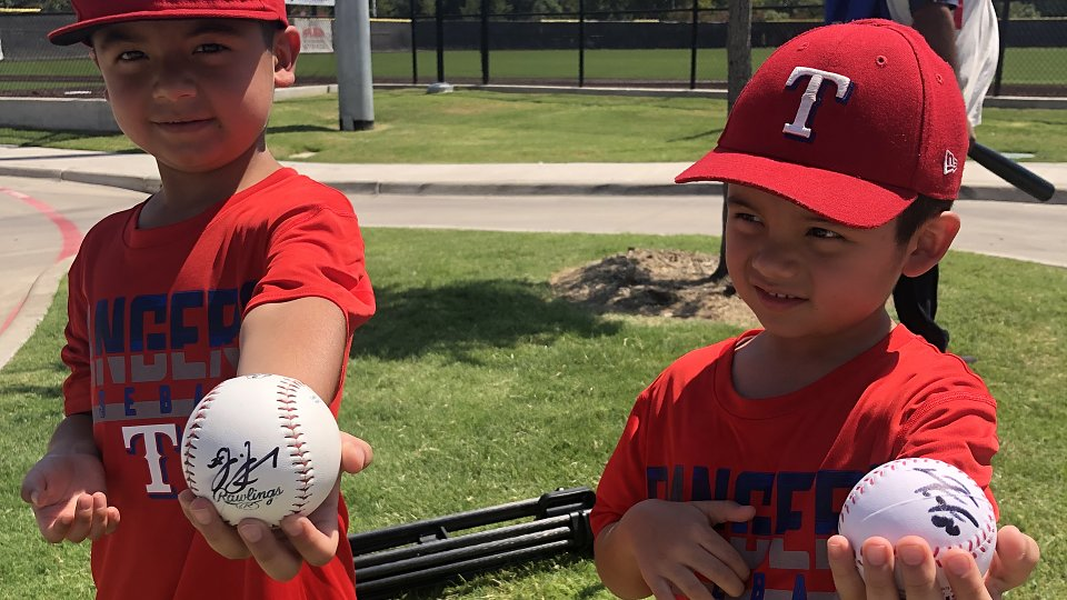 children have baseballs signed by rangers nomar mazara