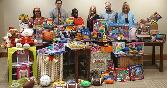 Friday photo: City Credit Union donates toys, money to Buckner