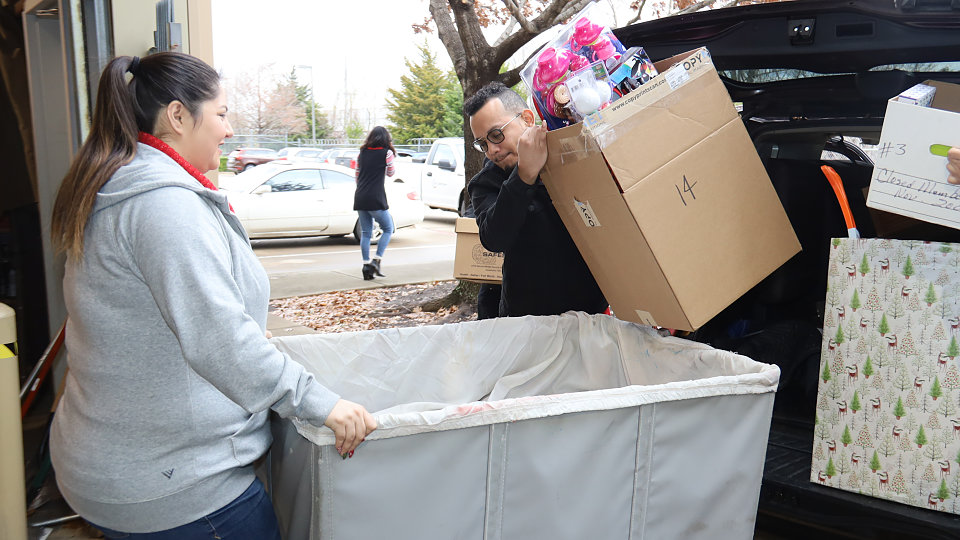 city credit union delivers toys to buckner