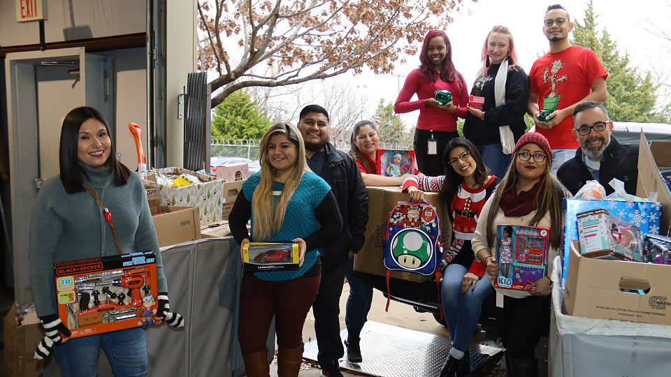 city credit union employees donated over 125 toys to buckner