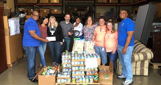 Friday photo: City Credit Union donates food to Buckner