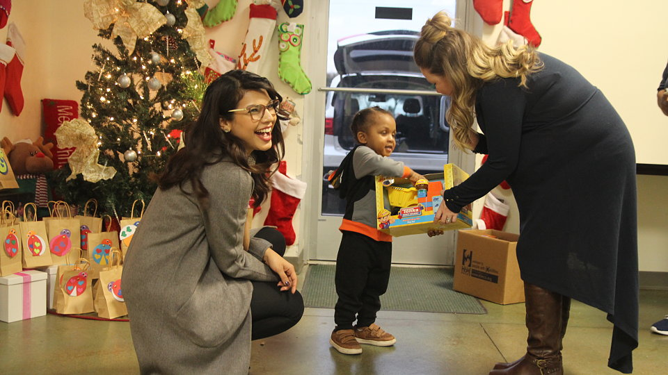 dallas city credit union 2018 toy drive child receives toy