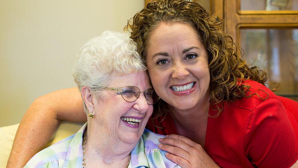 senior citizen with nursing assistant