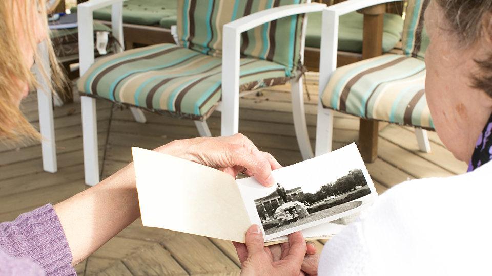 senior looking at old photo