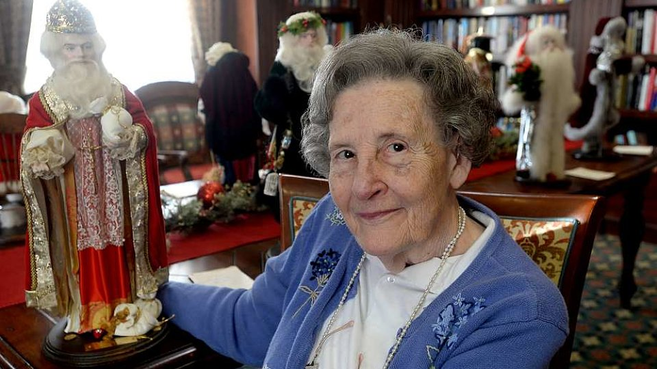 senior woman showing antiques.