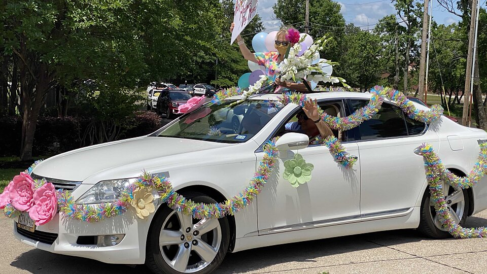 family and friends supported seniors during car parades