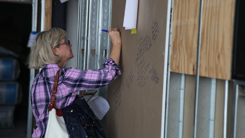 friends of buckner write blessings on the family hope center walls
