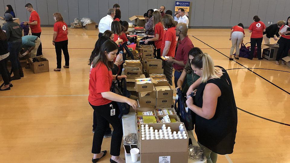 halliburton employees filled 760 backpacks with supplies for children served by buckner