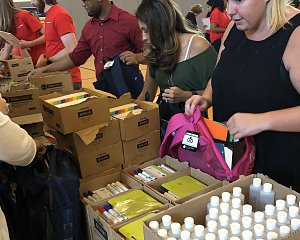 halliburton employees filled backpacks for children served by buckner in houston