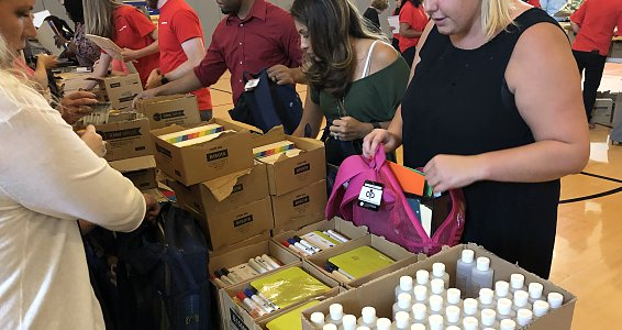 Halliburton Employees fill and donate 760 backpacks with school supplies for children served by Buckner