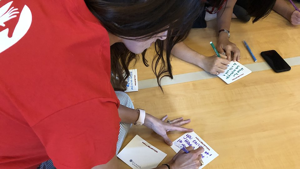 halliburton employees write notes of encouragement to children