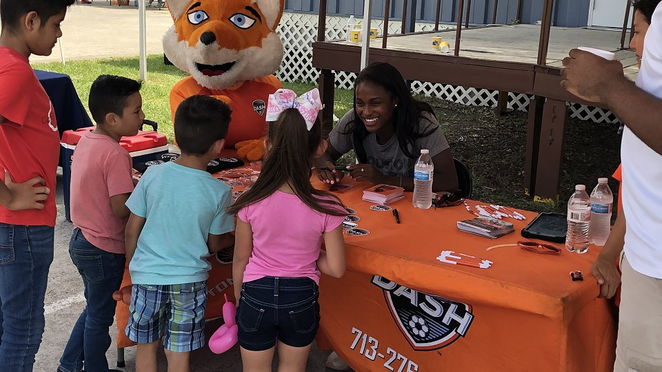 houston dash player nichelle prince signs autographs for children with family hope center