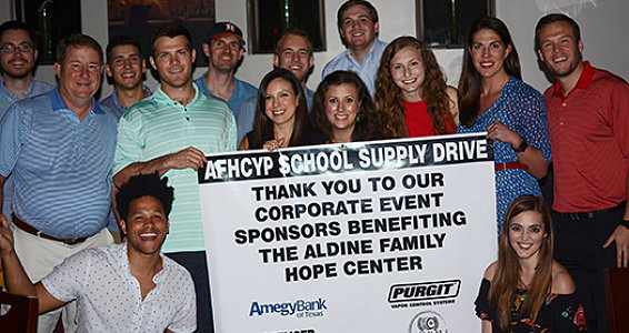 Young professionals raise $8,000 for school supplies