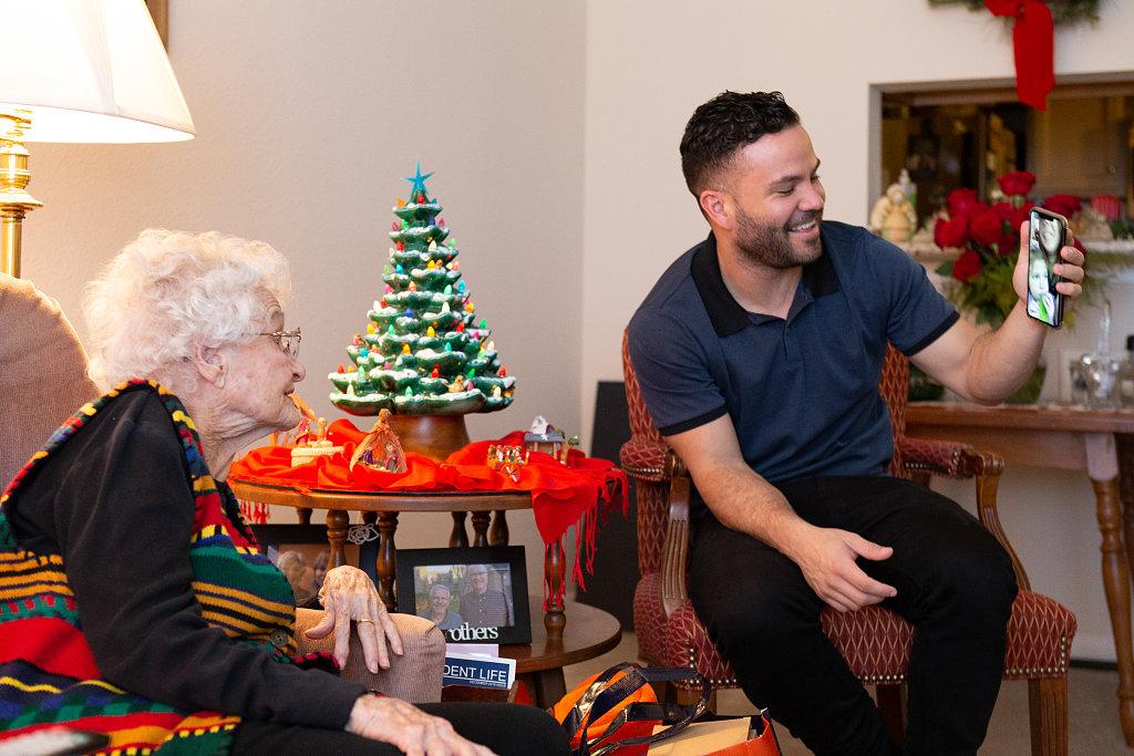 Jose Altuve facetimes with an elderly woman