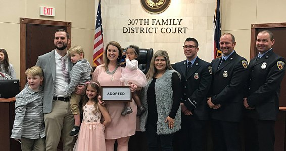 Firefighters who saved baby are there for her again on adoption day