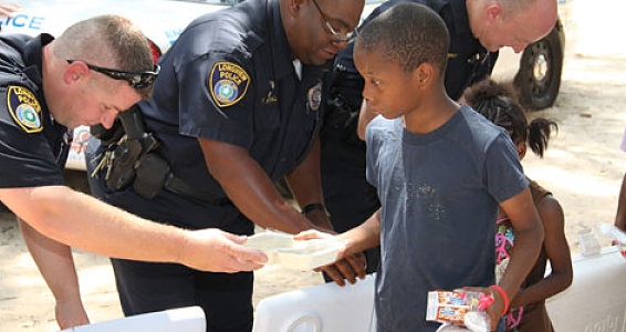 Longview Police Department Play Nice Guys at Buckner Feeding Program