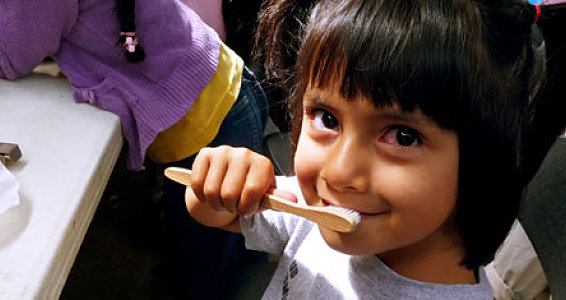 Bamboo toothbrushes give kids their smiles back