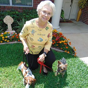 Sandy Taylor outside her Calder Woods townhome with dachshund Princess and Yorkie Benji.