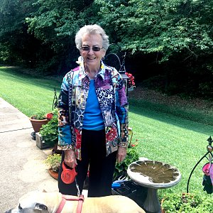 Lee Rose of Buckner Westminster Place with her dog, Aries.