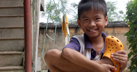 Vietnamese Child Receives 2 Millionth Shoe