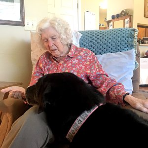 Joanne Payne of Buckner Westminster Place with her dog, Gracie.