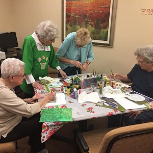 Painting masterpieces at a Buckner Villas painting class.