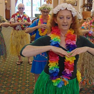 Learning to hula dance at the Calder Woods luau.