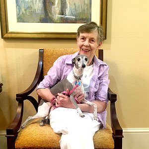 Kathy Hancock of Buckner Westminster Place with her dog, Cookie.