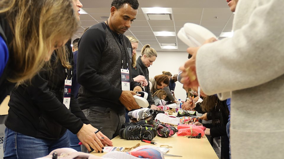 mlb representatives sorted and packed shoes for vulnerable children
