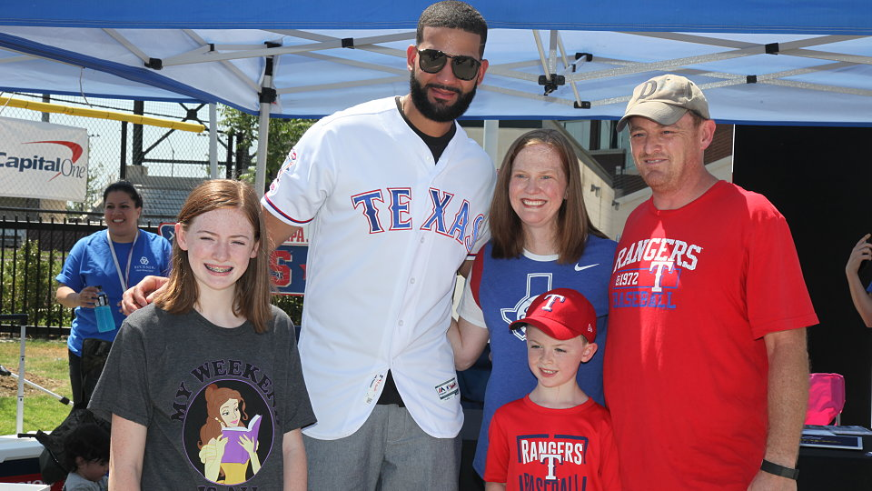 rangers nomar mazara meets with families donating shoes for buckner