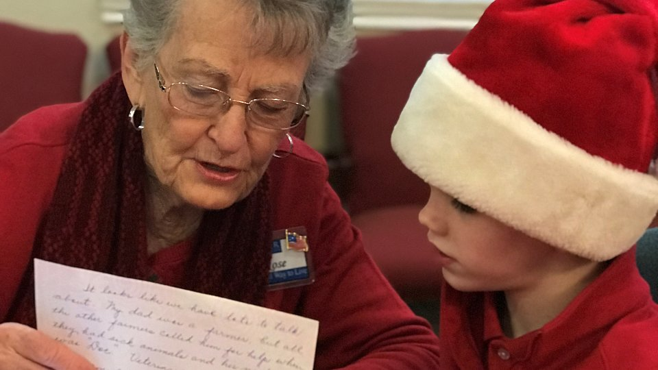 residents at buckner westminster place write letters to their elementary grade pen pals