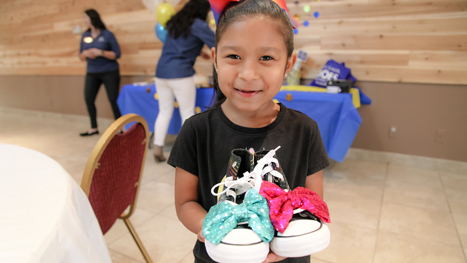 samantha receives special shoes from buckner shoes for orphan souls