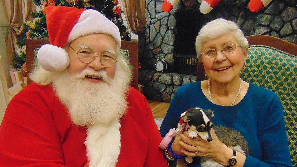 senior with dog and santa