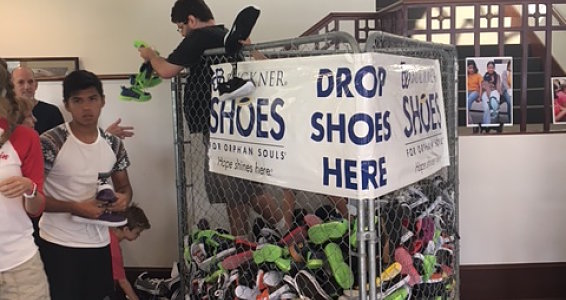 Friday photo: Preparing 10,000 shoes for flood victims