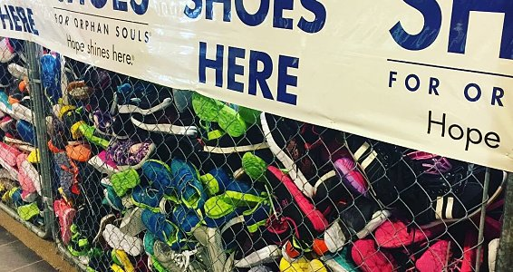 Buckner International, South Main Baptist Church donate 10,000 new pairs of shoes to flood victims