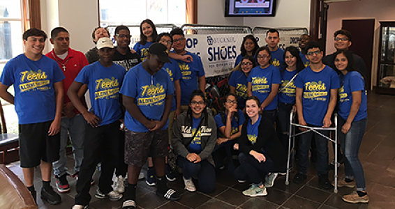 Buckner Family Hope Center students pitch in for shoe drive