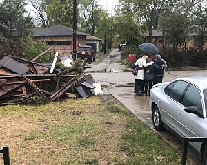 staff from buckner and communities foundation of texas pray for tornado victims