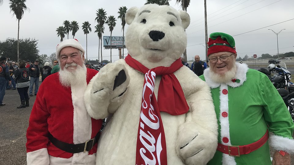 valley buckner foster care toy run santa elf and polar bear