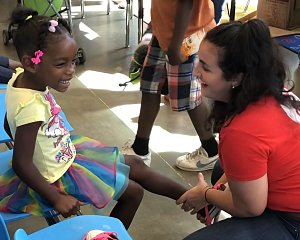 volunteers helped outfit buckner family hope center kids with new shoes for school