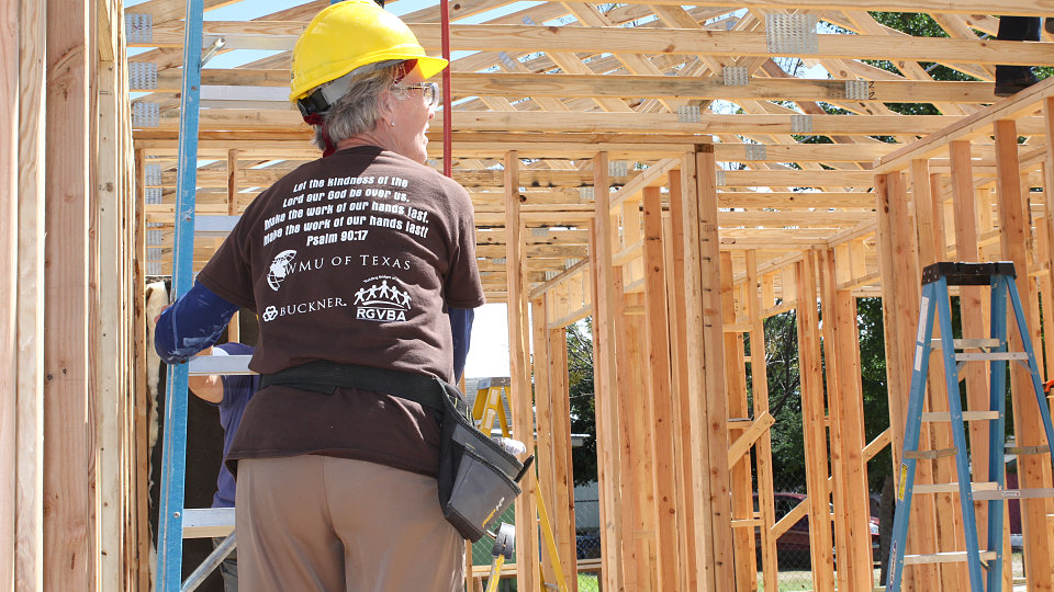 volunteers with wmu build home for buckner family